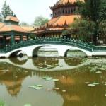Pagoda & a bridge over a lake, Ayutthaya, Muang Samut Prakan,Bangkok, Thailand — Stock Photo #56673463