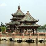 Pagoda on a bridge over a lake, Samut Prakan, Mueang Boran, Bangkok, Thailand — Stock Photo #58597747