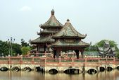 Pagoda on a bridge over a lake, Samut Prakan, Mueang Boran, Bangkok, Thailand — Stok fotoğraf