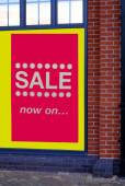 Sale now on. store's window sale sign. sale. sign. sale sign — Stock Photo