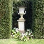Sculptured urn on a plinth — Stock Photo #59749009