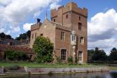 Ornate moated Tudor architecture — Stock Photo
