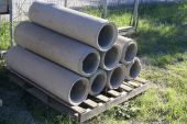 Cement pipes on a pallet — Stock Photo