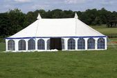 Tent in a field. marquee for event or show. tent for a celebration, event, or show — Stock Photo