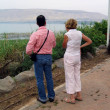 Tourists looking at The Sea of Galilee, Kinneret, Lake of Gennesaret, or Tiberias, Israel — Stock Photo #64018281
