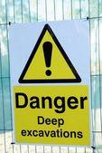 Danger deep excavations sign. keep back. — Stock Photo