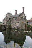 Tudor moated architecture with a bridge — Stock Photo