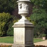 Sculptured urn on a plinth — Stock Photo #68937703