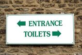 Entrance. toilets. sign. entrance and toilets sign — Stock Photo