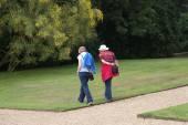 Women walking in a park — Stock Photo