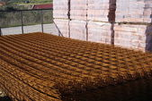 Products of red bricks and iron net for construction — Stock Photo