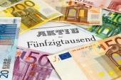 Share with Euro banknotes — Stockfoto