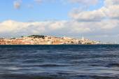 View across river Tagus towards historic city of Lisbon — Stock Photo