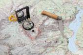 Compass and wooden-handled knife on a hiking map of the Berchtesgaden Alps — Stock Photo