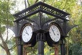 World clock near orchid garden in Singapore Botanic Gardens — Stock Photo