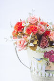 Colorful flowers in a vase on white background — Stock Photo
