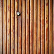 Door lens peephole on wooden texture — Stock Photo #63399627
