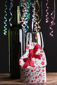 St Valentine's setting with present and red wine — Stock fotografie