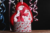 St Valentine's setting with present and red wine — Fotografia Stock