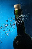 Bottle neck on water with bubbles — Stock Photo
