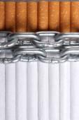 Chained cigarettes. Conceptual image. — Stockfoto