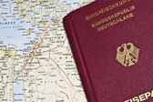 Close-up of a German Passport with a map of the Middle East — Stock Photo