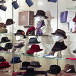 Collection of hats in a shop window — Stock Photo #58307197