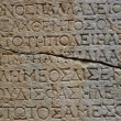 Old letters on the stone in Phaselis — Stock Photo #73006865