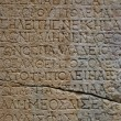 Old letters on the stone in Phaselis — Stock Photo #73007081