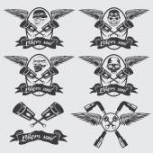 Biker theme labels with pistons and skulls with wings — Stock Vector