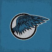 Grunge vintage sport label with wings — Stockvektor