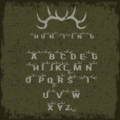 Grunge hunting alphabet with horns — Stock Vector