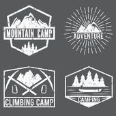 Set of vintage labels mountain adventure and camping — Vector de stock