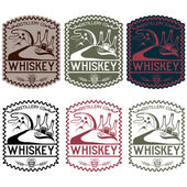Vintage vector labels of whiskey with copper whiskey still and m — Stock Vector