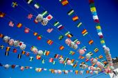 Multi-national bunting at a fiesta — Stock Photo