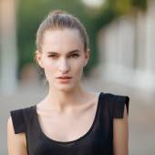 Closeup street portrait of a young fashionable woman with natural light and shallow depth of field — Stock Photo