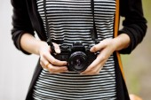 Women's hands holding the vintage film camera — Stock Photo