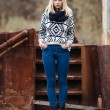 Young cute blonde woman in sweater, scarf, and jeans outdoors portrait with abandoned grunge background — Stock Photo #59326467