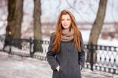 Lifestyle portrait of young beautiful redhead woman in coat and scarf in winter park — Stock Photo