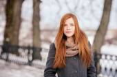 Winter closeup portrait of a cute redhead lady outdoors — Stock Photo