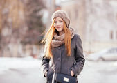 Winter portrait of a cute redhead lady in grey coat and scarf outdoors — Foto Stock