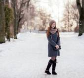 Winter full length portrait of a cute redhead lady in grey coat and scarf outdoors — Stock Photo