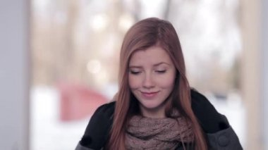 Young beautiful redhead woman in scarf and grey coat winter park outdoors — Stock Video