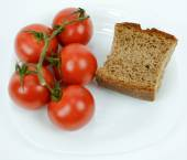 Mediterranean diet brown bread and tomato — Stock Photo