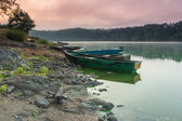 Early morning mist over the river, the boat and the silence around. — Stock Photo
