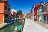 People are walking in Burano on July 16, 2012 in Venice. — Stock Photo