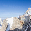 View of the Alps from Aiguille du Midi mountain in the Mont Blanc massif in the French Alps. Summit tourist station in foreground. Alps, France, Europe. — Stock Photo #62107631