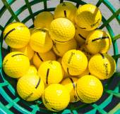 Golf balls in a basket — Stock Photo