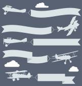 Silhouettes of biplanes with wavy greetings banner — Stok Vektör