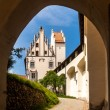 Hohes schloss through a portic. Castle in the middle of Fussen, — Stock Photo #77887524